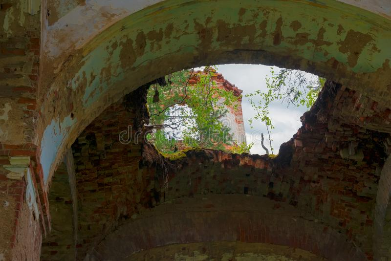 Failure in the dome of the church. Ruined Church of the Kazan icon of the Mother of God. The Village Of Russian Noviki. Valday district, Novgorod region, Russia stock photos