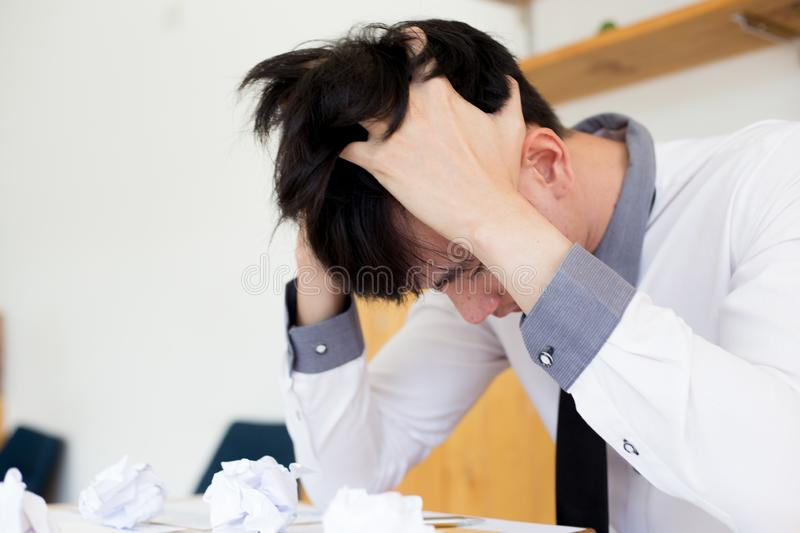 Failure, Male employees malfunction causes the company`s income to drop,. Young man are stressed due to erroneous work royalty free stock photography