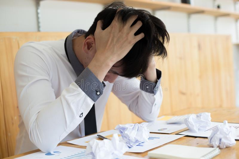 Failure, Male employees malfunction causes the company`s income to drop,. Young man are stressed due to erroneous work stock image