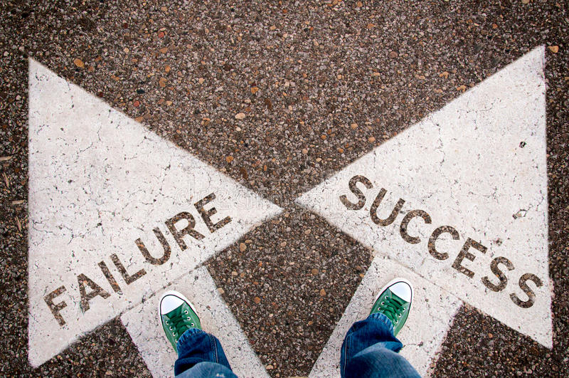 Failure and success. Dilemma concept with man legs from above standing on signs royalty free stock photos