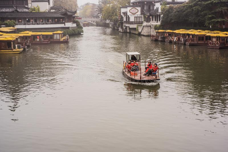 A faint foggy day, a small motor boat driving on the Qinhuai River royalty free stock photo