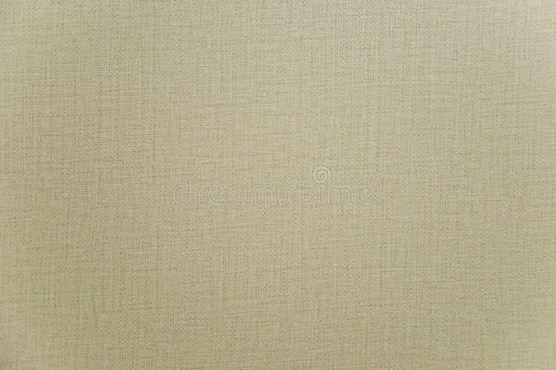 Faint yellow nylon background texture, linen stock photography