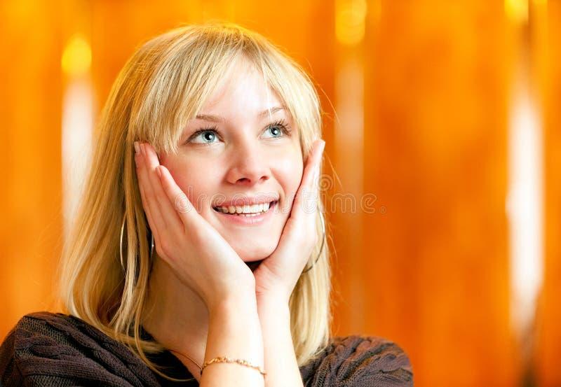 Fair-haired girl smiles