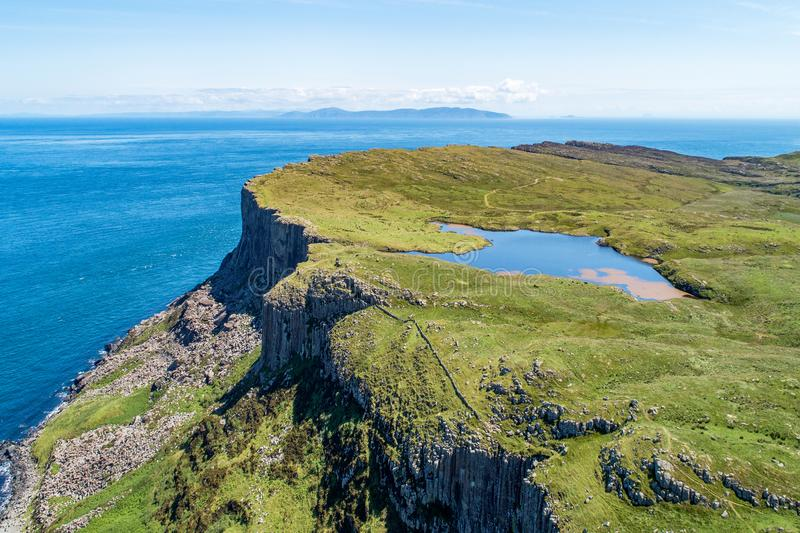 Fair Head cliff in Northern Ireland, UK. Fair Head big cliff and headland at the north-eastern corner of County Antrim, Northern Ireland, UK. Aerial view with stock photography