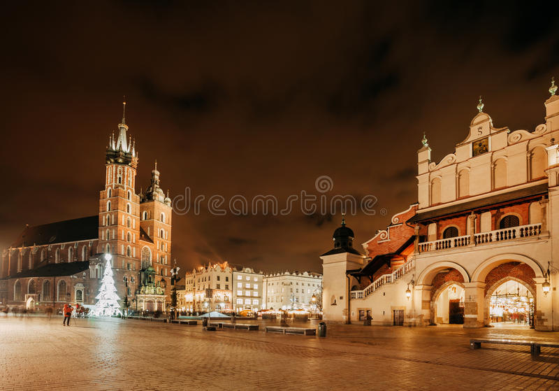 Fair in KRAKOW. Main Market Square and St. Mary`s Basilica stock photo