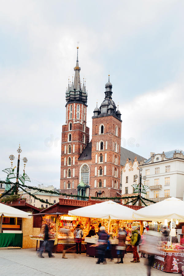 Fair in KRAKOW. Main Market Square and St. Mary`s Basilica stock photography