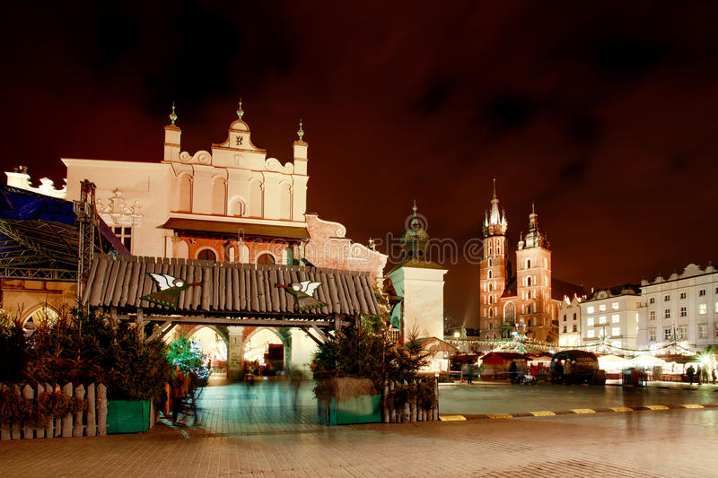 Fair in KRAKOW. Main Market Square and St. Mary`s Basilica royalty free stock image