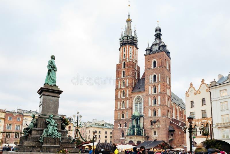 Fair in KRAKOW. Main Market Square and St. Mary`s Basilica royalty free stock photo