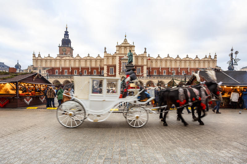 Fair in KRAKOW. Main Market Square and Sukiennice in the evening. royalty free stock image