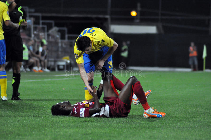 Fair play after fault. CLUJ-NAPOCA, ROMANIA - SEPTEMBER 2: Fair play of M. Laurentiu (yellow) after a fault against M. Sougou (red) during a match between CFR stock image