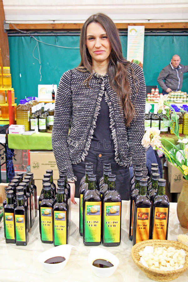 Fair 'Products of Croatian Village',girl sells pumpkin's oil,Zagreb,2016. royalty free stock photo