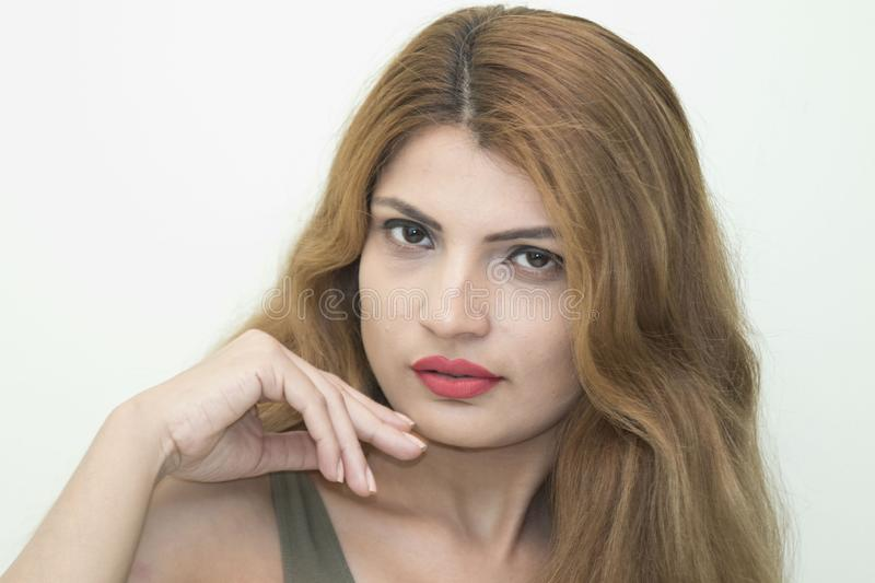 A fair skin lady`s stylish. A fair skin lady`s beautiful portrait photograph with sharp features stock photography