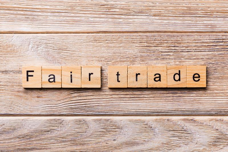 Fair trade word written on wood block. fair trade text on wooden table for your desing, concept.  stock images