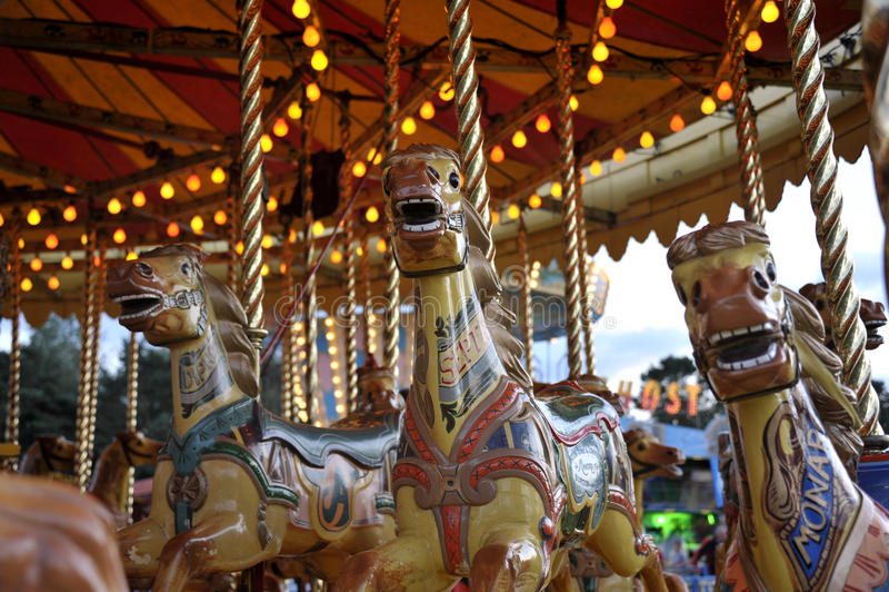 Fair. Vintage amusement fairground steam gallopers also called carousel or merry go round horse ride stock photos