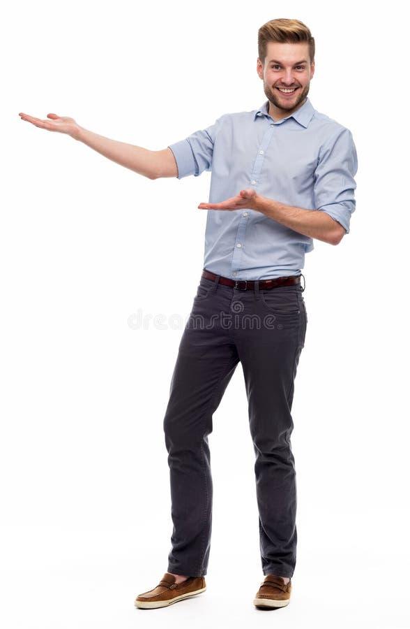 Faire des gestes de jeune homme photo stock