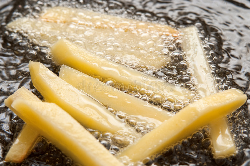 faire frire de pommes frites images libres de droits