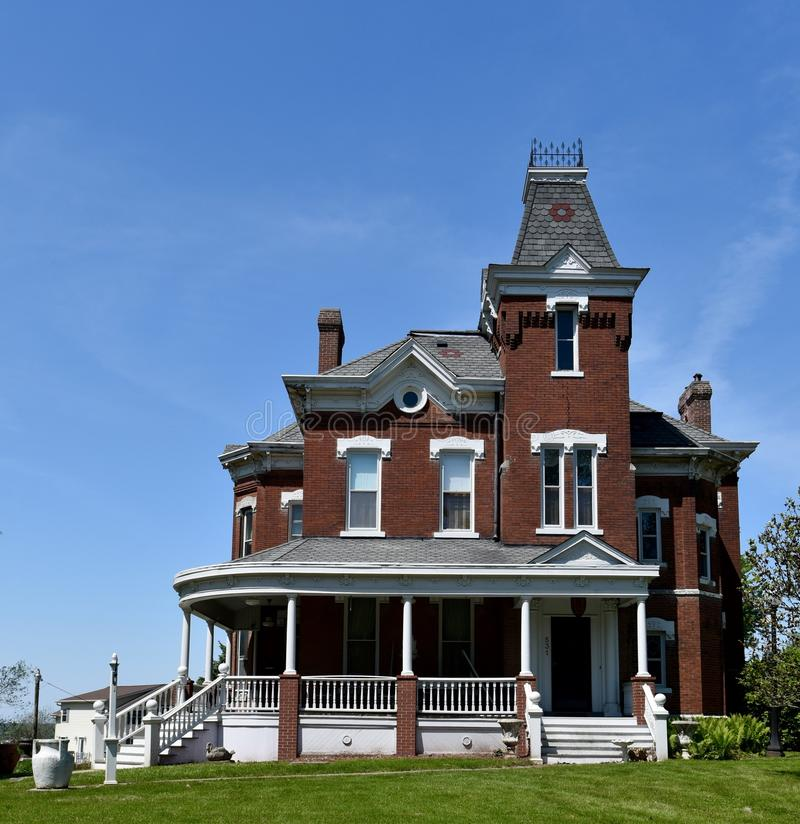 Fairfield Victorian Italianate. This is a Spring picture of a magnificent house located in Fairfield, Iowa. This house built in 1893 is an example of Victorian stock image