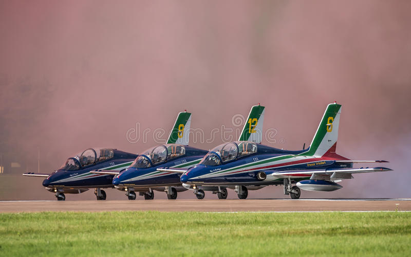 FAIRFORD, UK - JULY 10: MB-339 Aircraft participates in the Royal International Air Tattoo Air show event July 10, 2016. FAIRFORD, UK - JULY 10: Italian Air royalty free stock photos