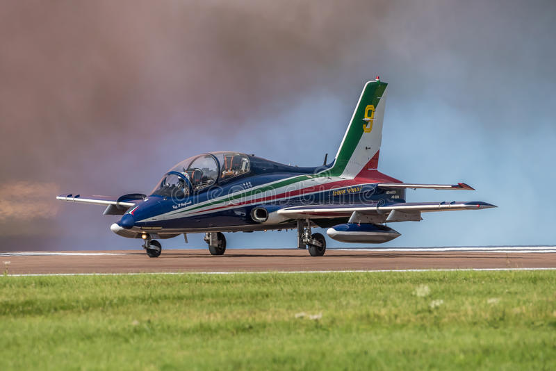 FAIRFORD, UK - JULY 10: MB-339 Aircraft participates in the Royal International Air Tattoo Air show event July 10, 2016. FAIRFORD, UK - JULY 10: Italian Air royalty free stock photography
