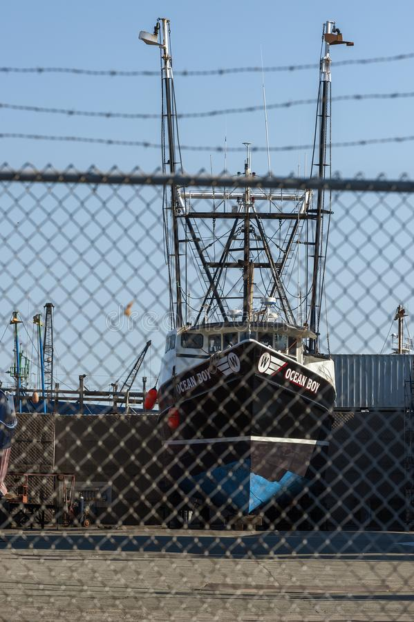 Commercial fishing boat Ocean Boy hauled out at shipyard royalty free stock photo