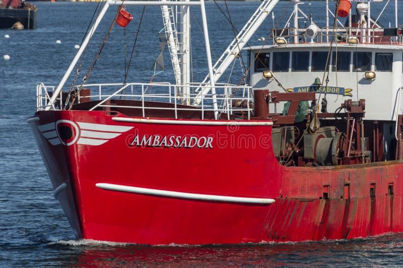 Bow shot of fishing vessel Ambassador. Fairhaven, Massachusetts, USA - May 21, 2018: Eastern rigged commercial fishing vessel Ambassador as she heads out of port stock photos