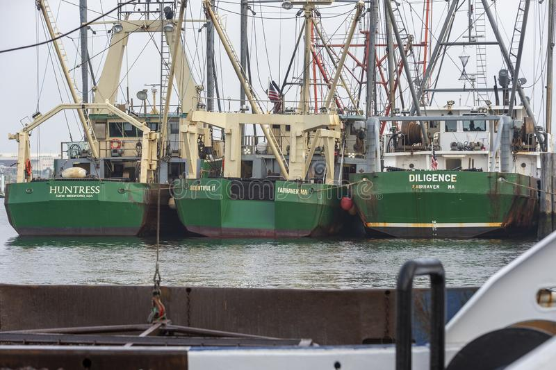 Commercial fishing vessels Huntress, Bountiful II and Diligence docked in Fairhaven. Fairhaven, Massachusetts, USA - September 22, 2019: Docked fishing boats stock photos
