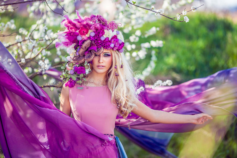Fairies are real. Beautiful Woman wearing a flower crown symbolizing spring - all images in this series shot with an open aperture - very shallow depth of royalty free stock photos