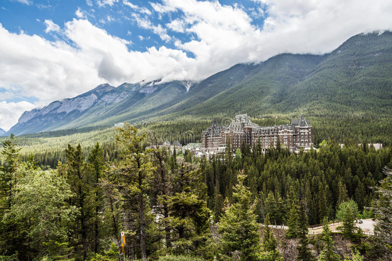 Fairmont Banff Spring Hotel and the Sulphur Mountain in Banff. Fairmont Banff Spring Hotel surrounded by the beautiful green forest, pine trees, alpine trees and stock images