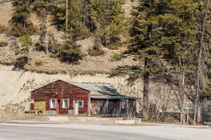 FAIRMONT HOT SPRINGS, CANADA - MARCH 22, 2019: old house or storage near the road in small town royalty free stock images