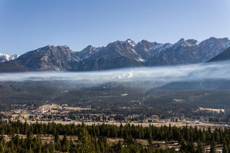 Fairmont Hot Springs, Canada - March 21 2019: panorama view to small town at the foot of a high mountain range stock images