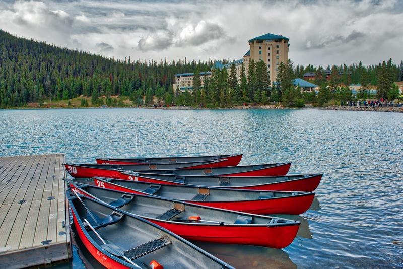 Kayaks at Fairmont Hotel Lake Louise. The Fairmont Hotel at Lake Louise in the Canadian Rockies, is a five star luxury hotel set in the National Park. Here stock photos
