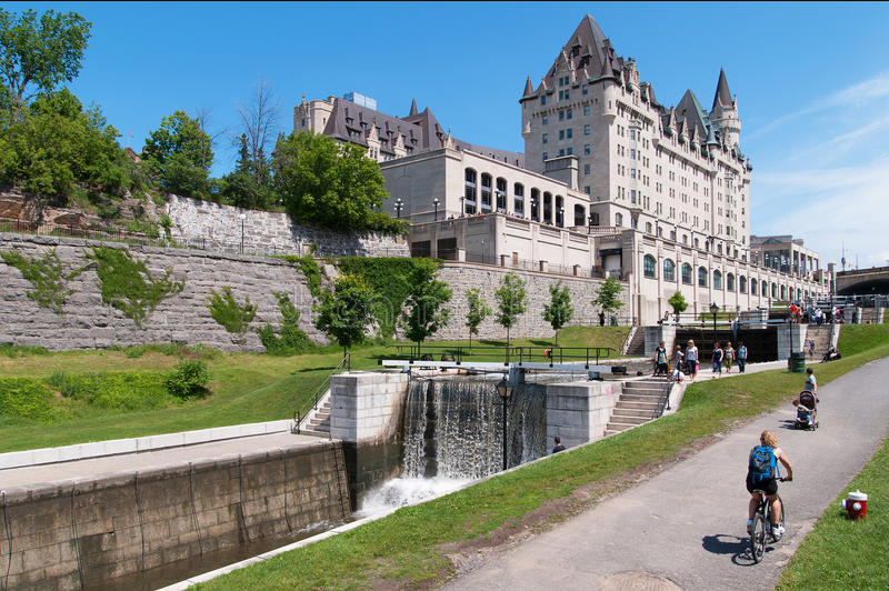 Fairmont Laurier Castle Hotel. OTTAWA, CANADA - JUNE 09, 2012: Fairmont Laurier Castle Hotel viewed from Ottawa Locks during summer, a favorite destination for royalty free stock photo