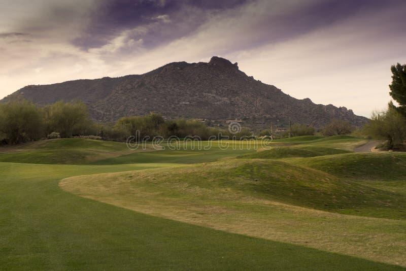 Fairway of beautiful Arizona golf course mountain backdrop royalty free stock photos
