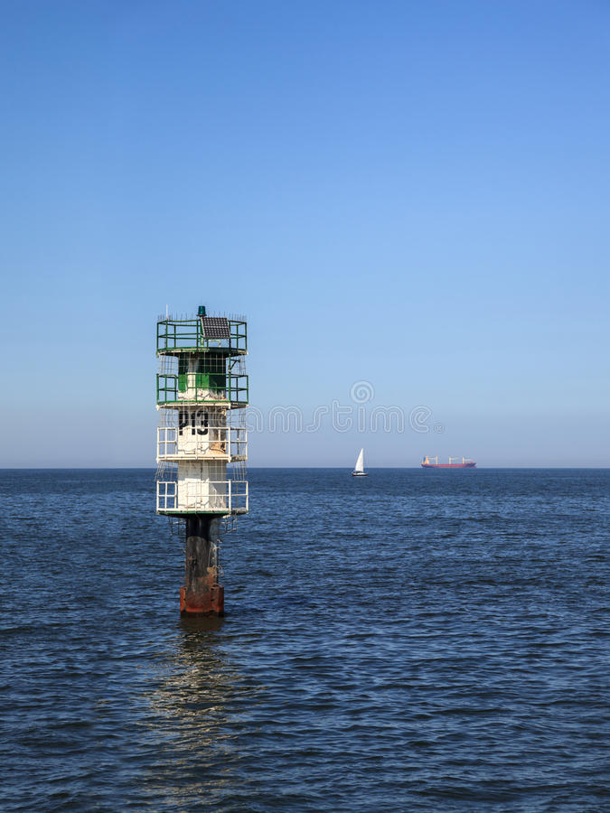 Fairway in a sea. Fairway with green buoy in a sea royalty free stock image