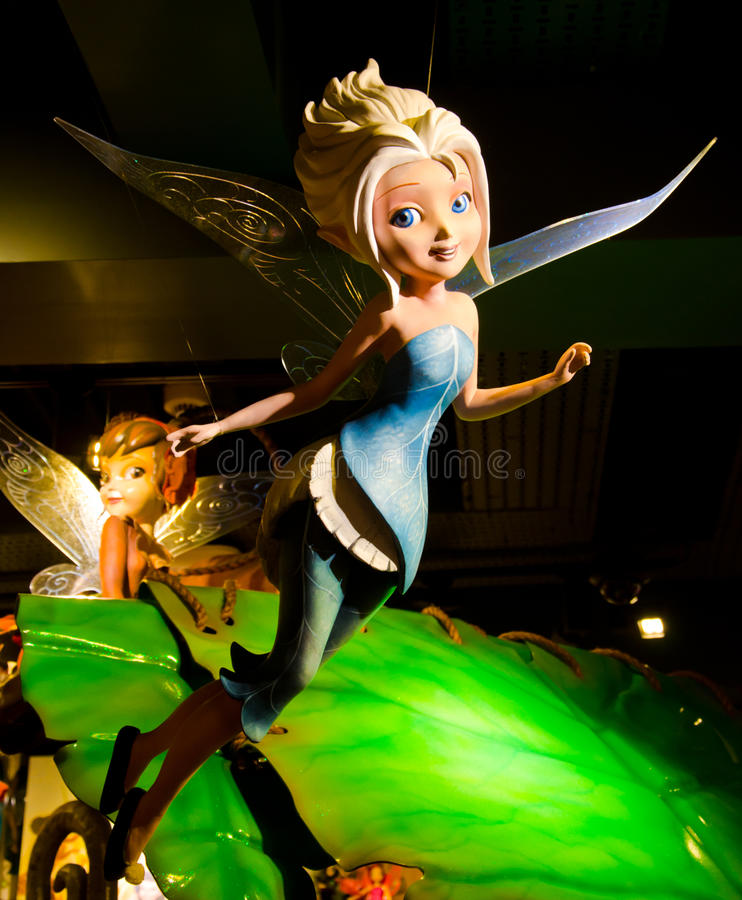 Fairy. Disney's little fairy doll on a black background stock illustration