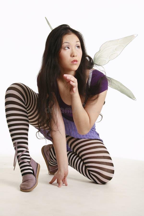 Fairy accovacciantesi fotografie stock