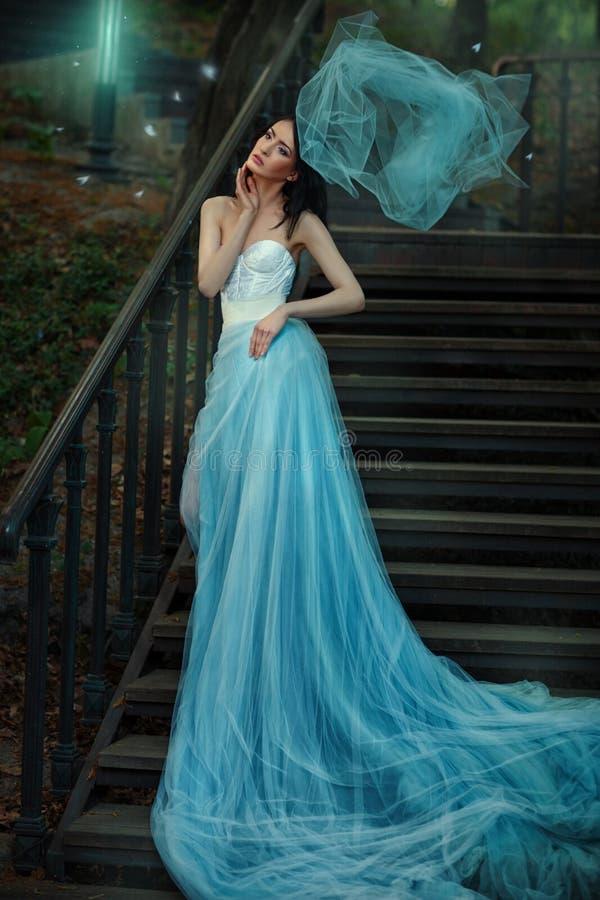 Fairy blue long dress of a fairy tale. royalty free stock photo