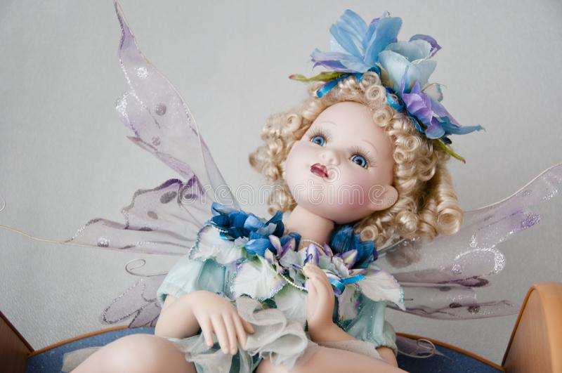 Fairy ceramic dall. lost in fairytale. childhood dream. toy shop. magical elf butterfly toy wings. believe in wonder. vintage royalty free stock image