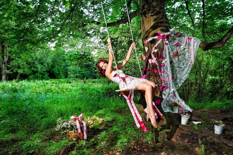 Fairy che oscilla sul teeterboard fotografia stock libera da diritti