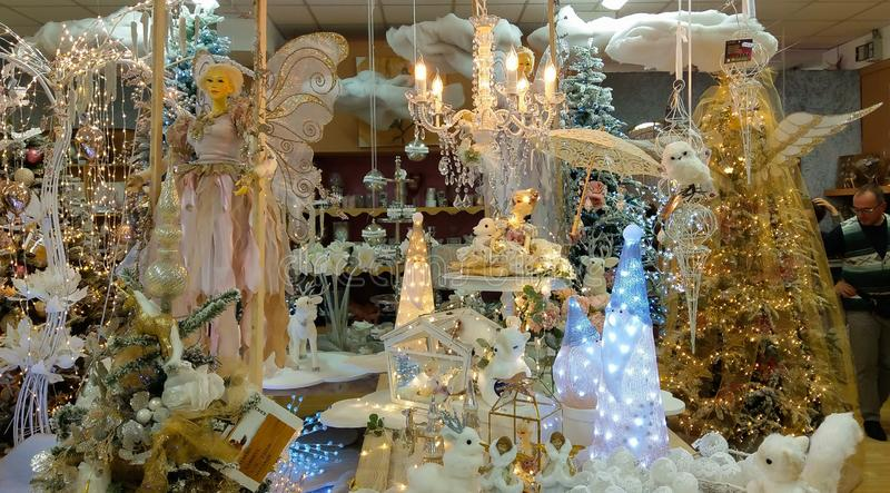 Fairy, christmas tree and decorations at the interior of big store royalty free stock photography