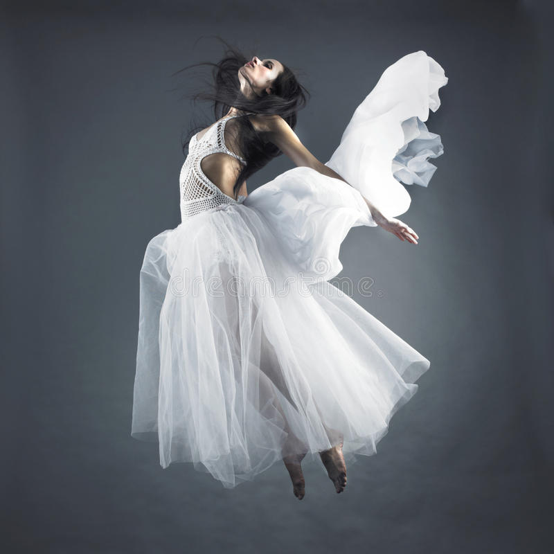 Fairy flying girl. Picture a beautiful fairy flying girl in white dress royalty free stock images
