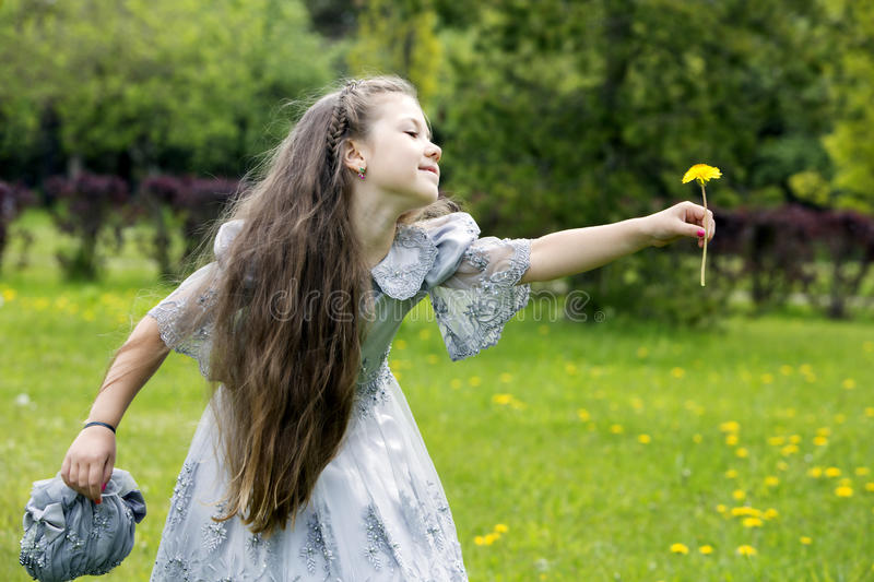 A fairy just landed from the wonderland. Girl giving flowers to her imaginary friend stock images