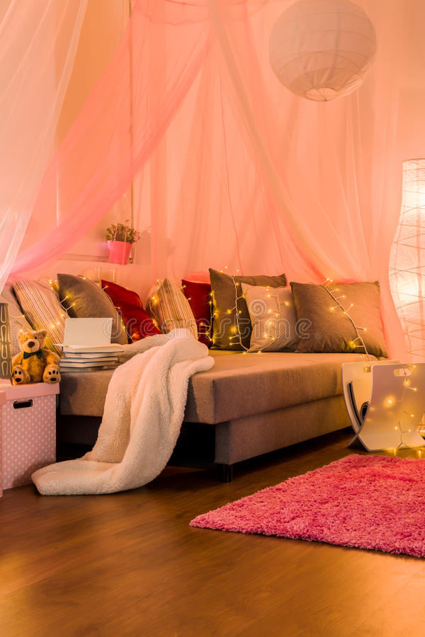 Fairy lights on the bed stock photos