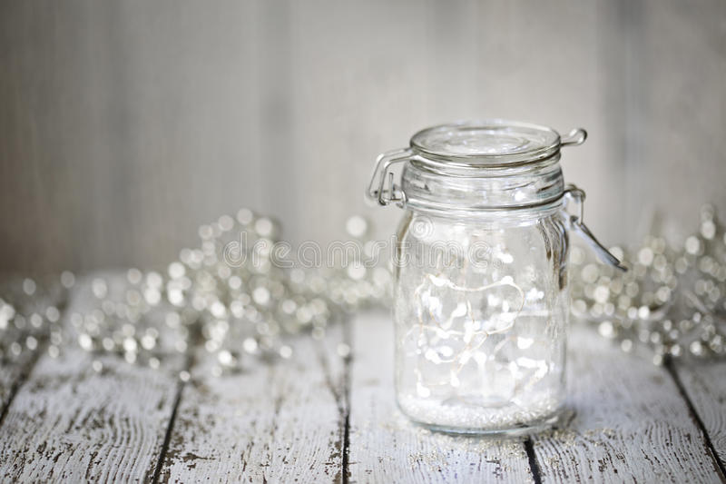 Fairy lights in a jar. With copy space royalty free stock photos