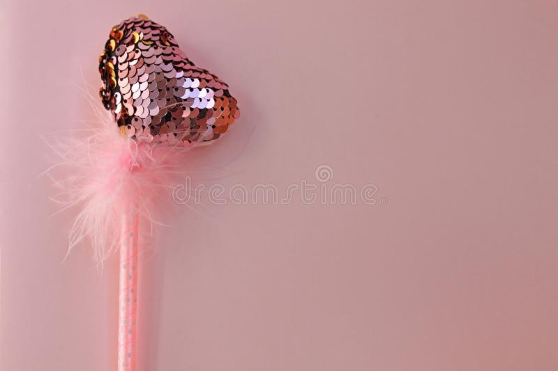 Fairy magic wand on a pink pastel background stock photo