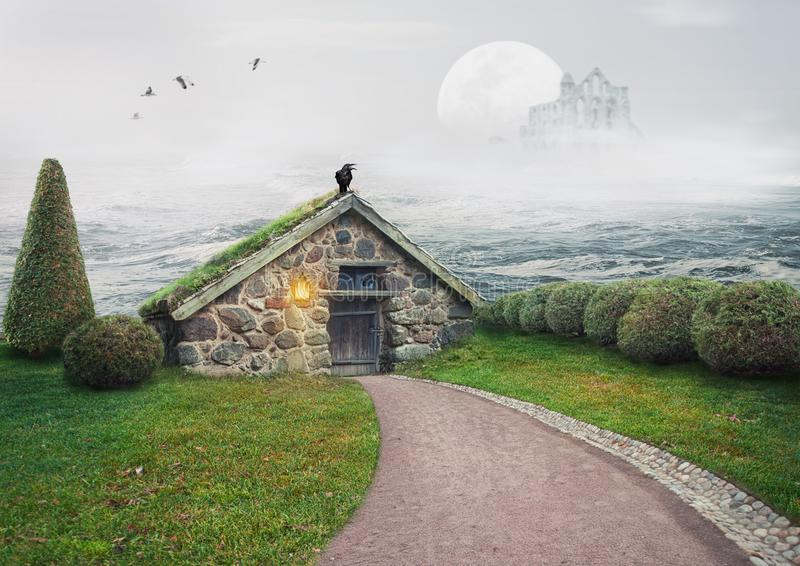 Fairy mystery house and fantasy castle in front of big moon in the sea stock image