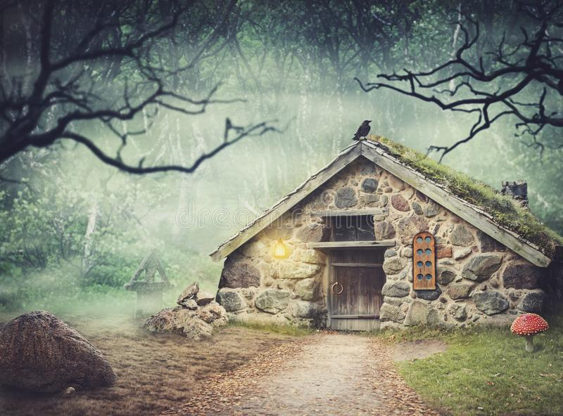 Fairy old stone house in fantasy forest with fog. Fairy old stone house in fantasy dark forest with fog royalty free stock image