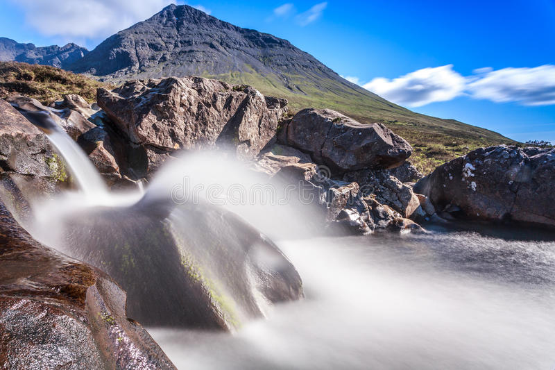 Fairy Pools, Isle of Skye. A waterfall at the Fairy Pools with the Cuillin mountains behind on the Isle of Skye stock photos