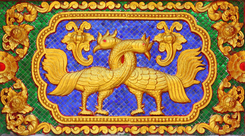 Fairy tale bird traditional thai style art molding stock image