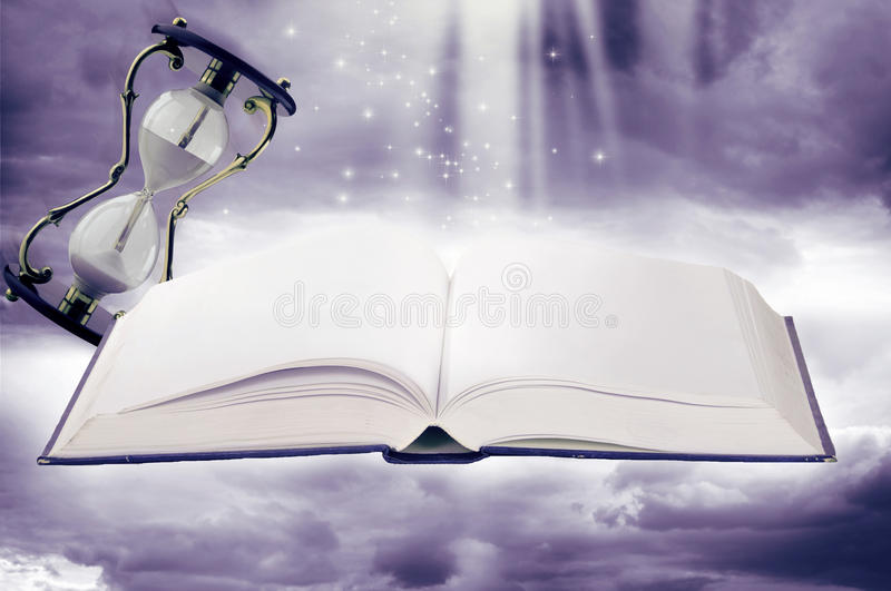 Fairy-tale book and sand-glasses stock photos
